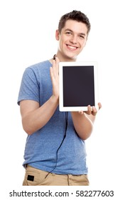 Happy Casual Teenage Boy with a Digital Tablet and Headphones - Looking in the camera - Isolated on White Background