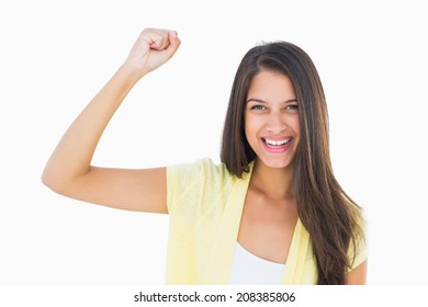Happy casual woman cheering at camera on white background