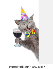 Happy Cat In Birthday Hat Holding Wineglass Isolated On White Background