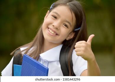 Happy Catholic Minority Girl Student With Books