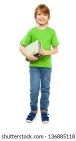 Happy Caucasian 9 years old boy in green shirt holding pile of books, full height portrait, isolated on white