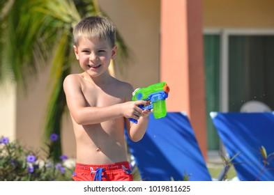 A happy Caucasian boy playing  and having fun in the swimming pool
