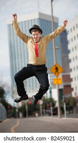 Happy Caucasian businessman jumps in the air