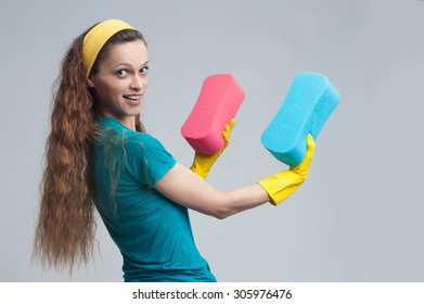 happy caucasian cleaning woman standing and holding sponge