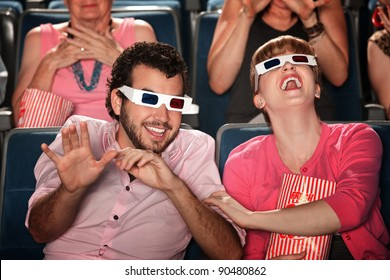 Happy Caucasian couple with 3D glasses in theater