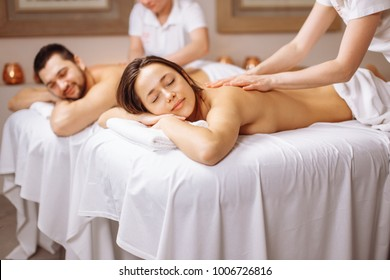 happy Caucasian couple enjoying a back massage.