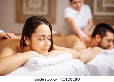 happy Caucasian couple enjoying a back massage.