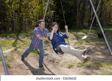 Happy Caucasian couple enjoys a beautiful day at the park