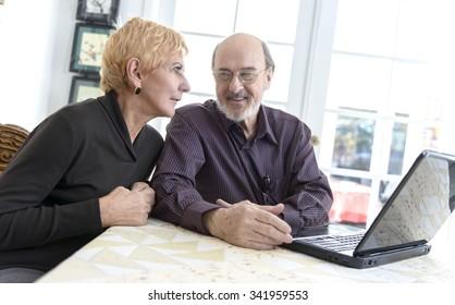 Happy Caucasian elderly men with short red hair talking
