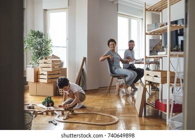 Happy Caucasian family enjoying their new apartment.