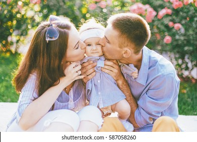 Happy caucasian family outdoors. Mother, father and child playing