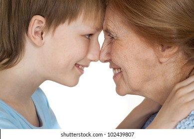 Happy Caucasian grandmother with her grandson on a white background