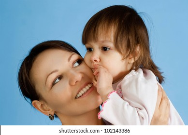 Happy Caucasian lady with a daughter on a blue background