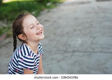 Happy Caucasian Little girl Long Blone Hair Happy Child LaughingWalk Park Outdoor Portret Copy space. Education Parenting
