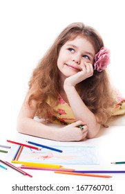 Happy caucasian preschooler daydreaming about the next thing she'll draw. Isolated on white background.