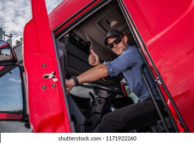 Happy Caucasian Semi Truck Driver Showing Thumb Up. Trucking Theme. Transport Industry.
