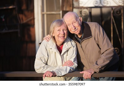 Happy Caucasian senior couple standing together outdoors