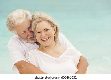 Happy Caucasian senior retired couple in white casual clothes outdoor together on luxury Caribbean vacation beach