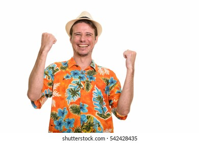 Happy Caucasian tourist man smiling isolated against white background