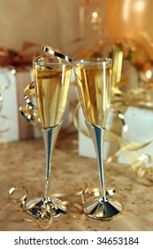 Happy Celebration of an Event With Champagne Glasses and Gifts