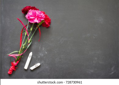 Happy chalk on blackboard with flowers teacher day abstract background