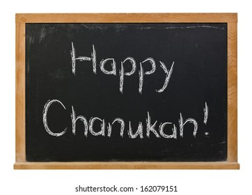 Happy Chanukah written in white chalk on a black chalkboard isolated on white