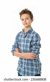 Happy charming Teenage Boy with brown hair, isolated against white wearing a blue white shirt