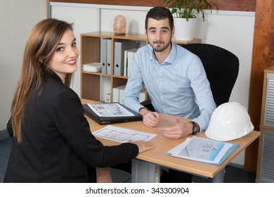 Happy and charming Young woman Discussing with consultant in office