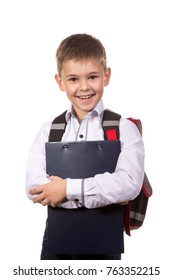 Happy cheeerful school boy hugging a black tablet folder in his hands. Standing on the clean white background