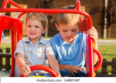 Happy and cheerful brothers are played at a playground