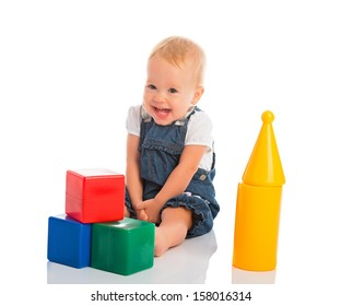 happy cheerful child playing with blocks cubes isolated on white background