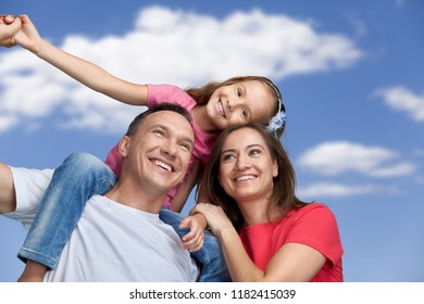 Happy cheerful family on background