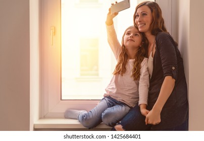 happy cheerful home family taking selfie