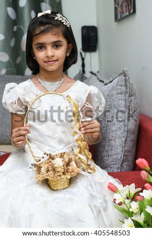 6b17af45cd Happy cheerful smiling cute little bridesmaid holding bunch flowers basket