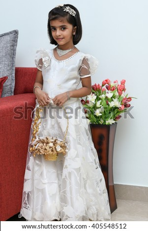 e2c29ca0438 Happy cheerful smiling cute little bridesmaid holding bunch flowers basket
