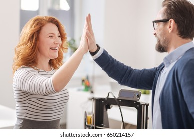 Happy cheerful woman giving his colleague a high five