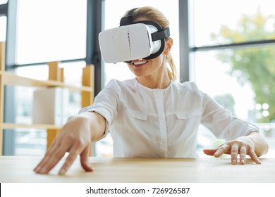 Happy cheerful woman wearing 3d glasses