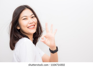 Happy cheerful women showing OK finger sign on white background