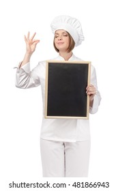 happy chef, cook or baker woman with empty blackboard making tasty gesture and enjoying food isolated on white background. restaurant and cooking concept. advertisement blank board. your text here