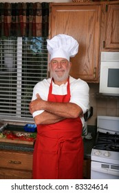 a happy chef prepares one of his famous dishes for someone while in his kitchen at a world famous bed and breakfast hotel restaurant.