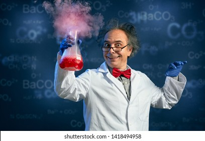 Happy chemist holding test tube with his successful experiment