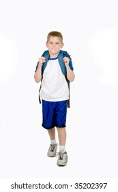 A happy child with a backpack walks towards the camera