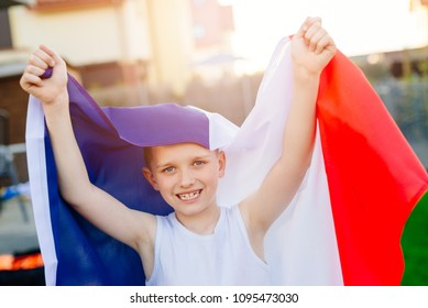 Happy child boy with France national flag. French football fan