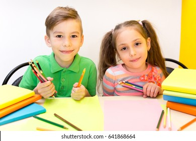 Happy child boy and girl with books and pencil