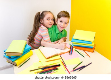 Happy child boy and girl with books. Children's friendship