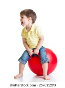 Happy child boy jumping on bouncing ball. Isolated on white.