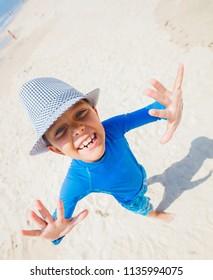 Happy child boy on beach. Summer vacation concept