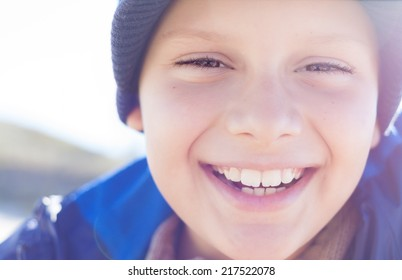 happy child boy smile closeup outdoor backlight