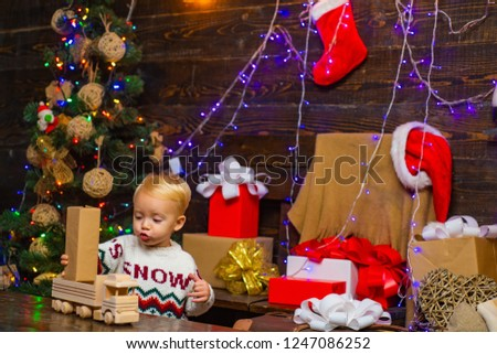 A Christmas Story Kid Now.Happy Child Christmas Present On Wooden Stock Photo Edit