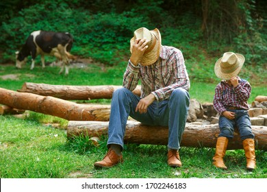 happy child with cowboy parent in nature in the field